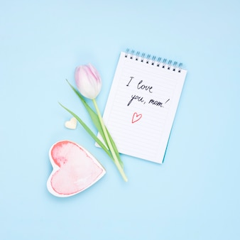 I love you mom inscription on notepad with tulip flower