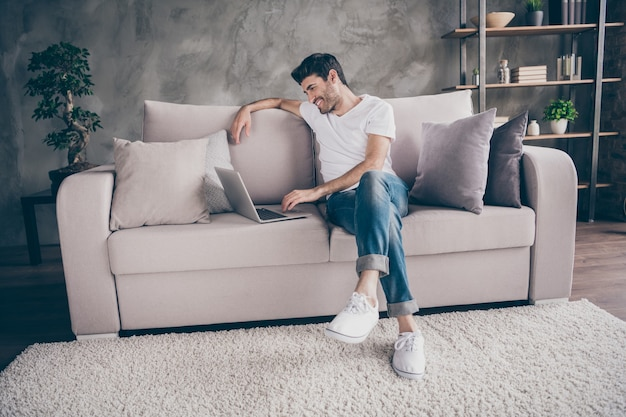 I miss you so much! profile photo of mixed race guy sitting cozy sofa holding notebook speaking skype with relatives communicating wear casual outfit flat loft living room indoors