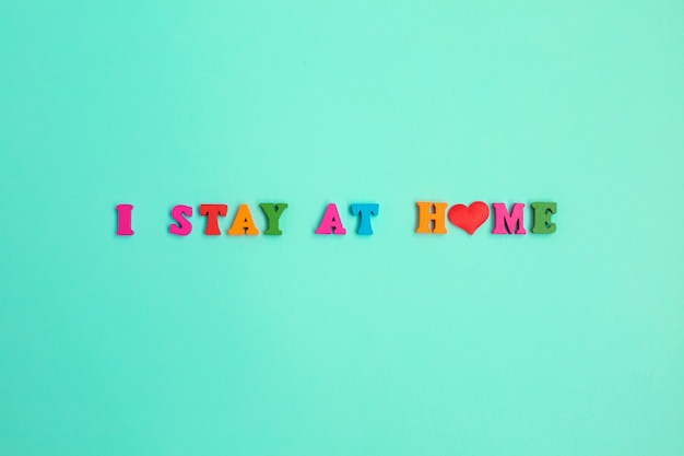 I stay at home phrase on blue wall.