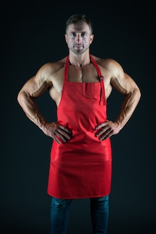 I will make it tasty. man attractive nude chef wear apron. sexy muscular chef black background. attractive chef cook. muscular chef bodybuilder. sport diet. delicious recipe. sexy macho cooking.
