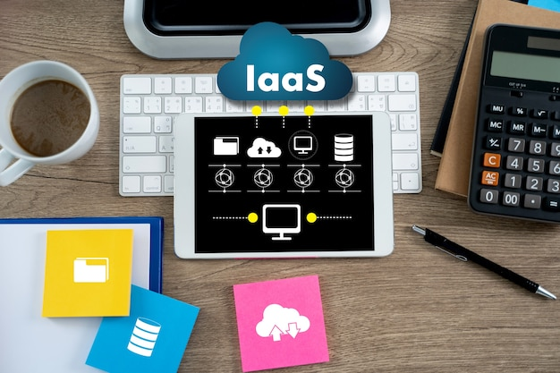 Iaas infrastructure as a service on screen on office desk