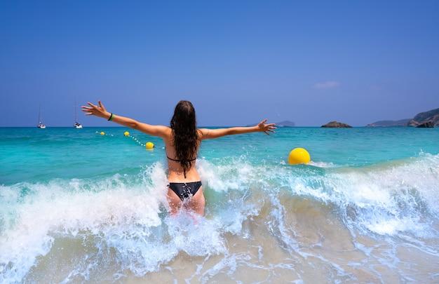 Ibiza beach girl splashing water in balearics