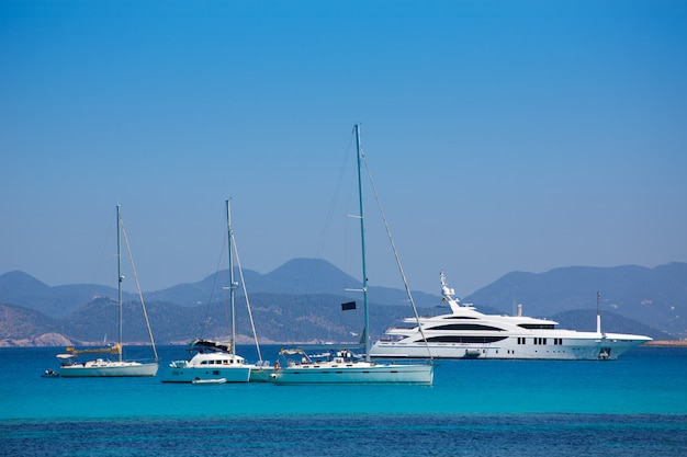 Ibiza coast view from formentera with anchor boats