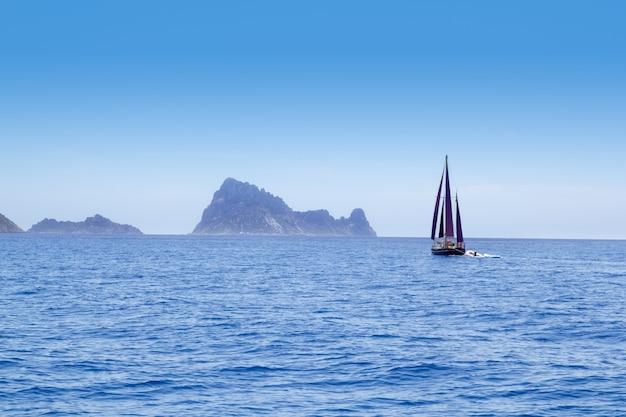 Ibiza red sails sailboat in es vedra