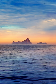Ibiza sunset in balearic islands view from sea