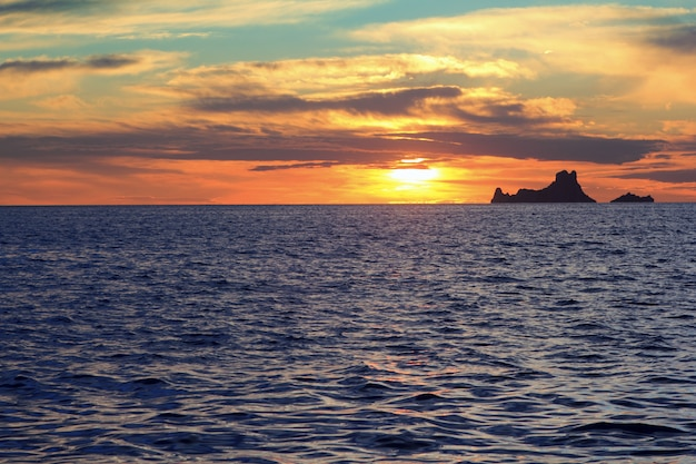 Ibiza sunset es vedra from formentera balearic