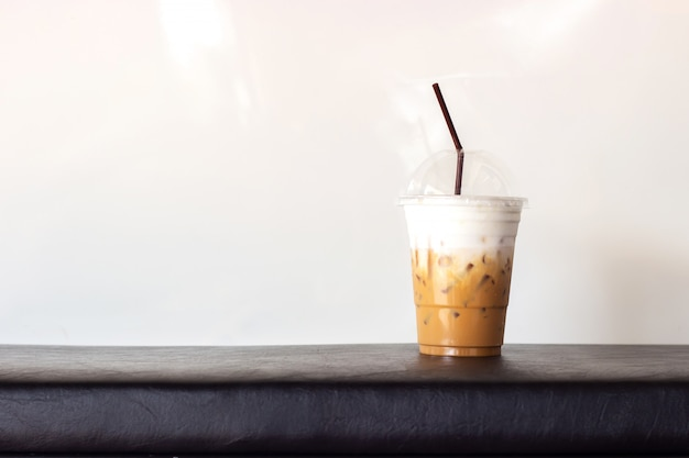Ice cappuccino in plastic cup. on white background with copy space. refreshment beverage.