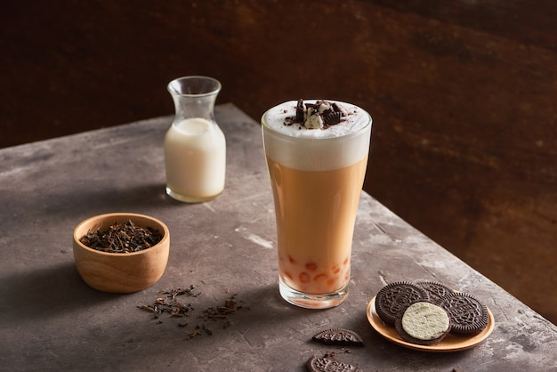 Ice cheese milk tea and bubble with chocolate cookies.