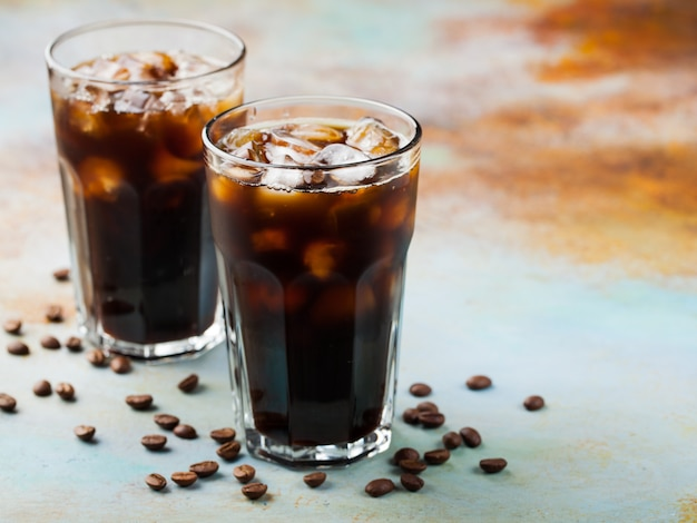 Ice coffee in a tall glass.