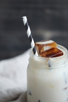 Ice coffee with striped straw