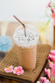 Ice coffee with whipped cream and topping on table