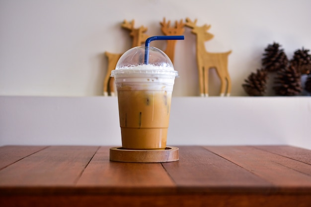 Ice coffee on wooden table at coffee shop food and drink