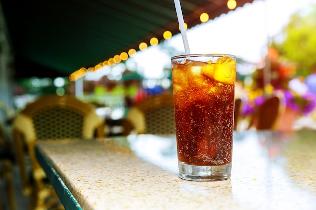 Ice cold cola with drinks a lemon on cocktails an outdoor