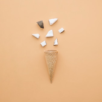 Ice cream concept with cone and coconut pieces