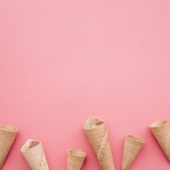 Ice cream concept with cones and copyspace