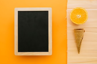 Ice cream concept with slate and orange slice