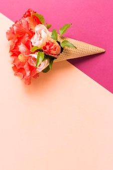 Ice cream cone with flowers with copy-space