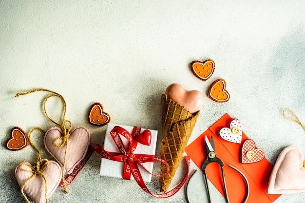 Ice cream cone with gift, envelope and scissors