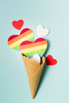 Ice cream cone with hearts in rainbow colors