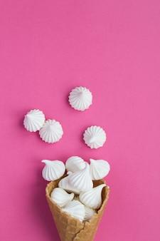 Ice cream cone with white meringue. top view. copy space.