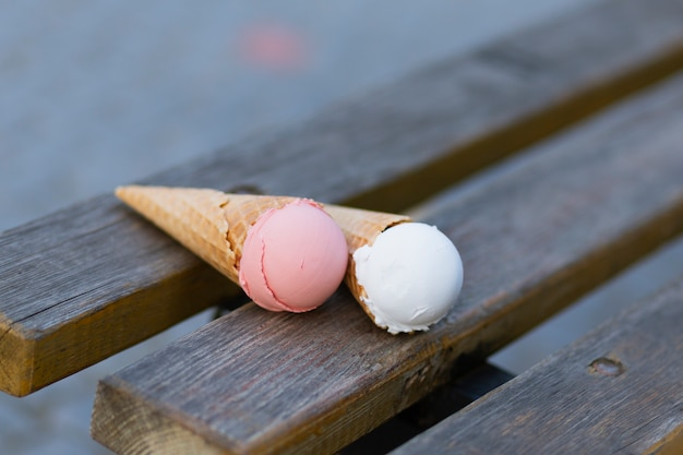 Ice cream cones on bench in park