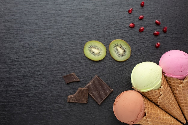Ice cream on cones with chocolate and kiwi