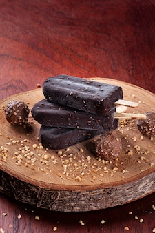 Ice cream covered with chocolate and chestnuts. chocolate popsicles. copy space