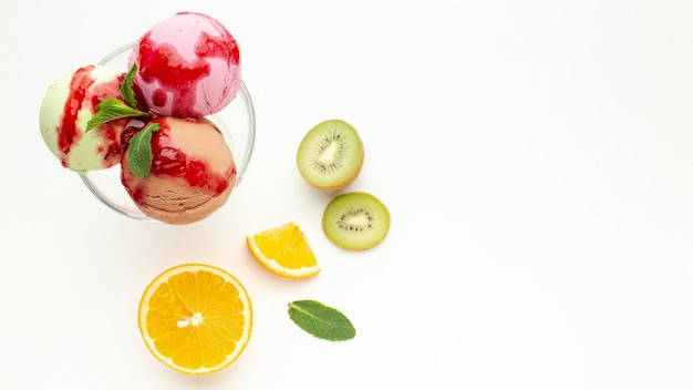 Ice cream cup in glass with fruits