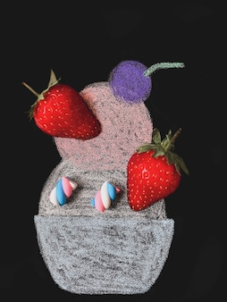 Ice cream drawn with chalk on a black background with strawberry pieces and small marshmallows as augmented reality.