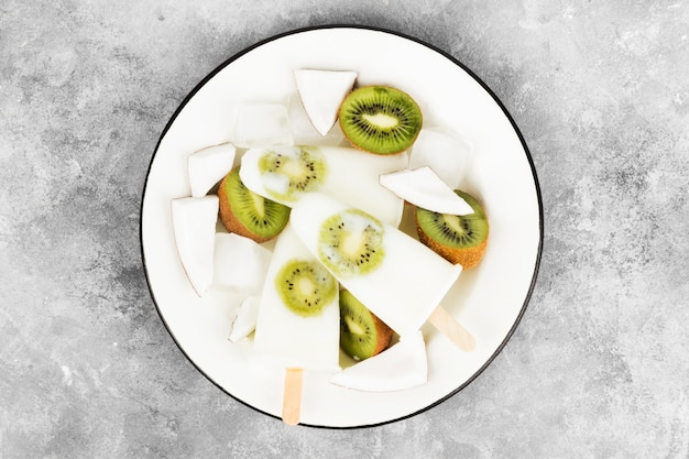 Ice cream from yogurt / coconut milk from kiwi on a light background
