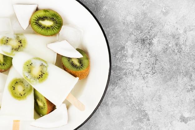 Ice cream from yogurt / coconut milk from kiwi on a light background