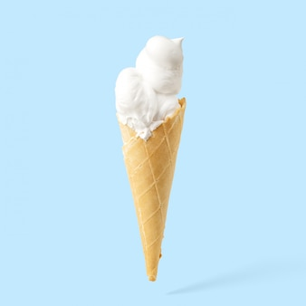 Ice cream in a horn on a blue background.