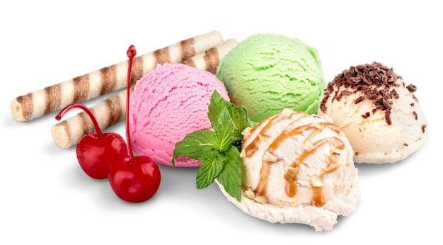 Ice cream scoops with wafers and cherries on white background