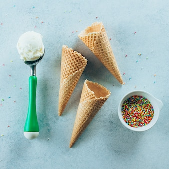 Ice cream spoon waffle cones and sprinkles. summer dessert ice-cream, yummy delicious treat
