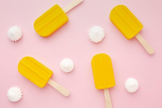 Ice cream on sticks on table