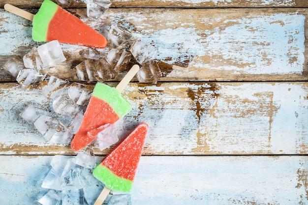 Ice cream sticks on a wooden background