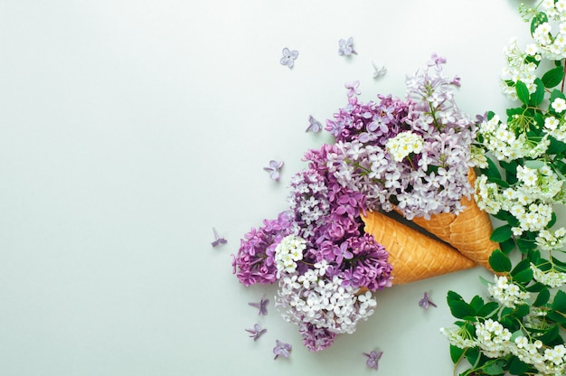 Ice cream waffle cones with lilac flowers