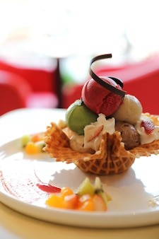 Ice cream on waffle and fruit topping