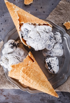 Ice cream with black sesame seeds. summer sweet dessert.