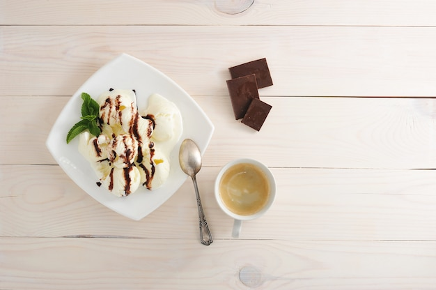 Ice cream with chocolate and coffee in a mag