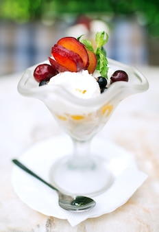 Ice cream with fruit on a table in a cafe