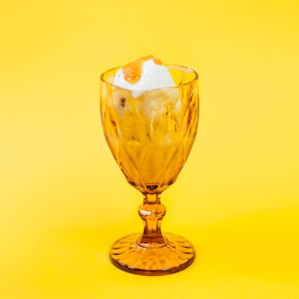 Ice-cream with topping in cup