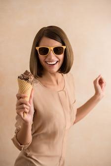 Ice cream woman singing in cone like in microphone happy, joyful and cheerful