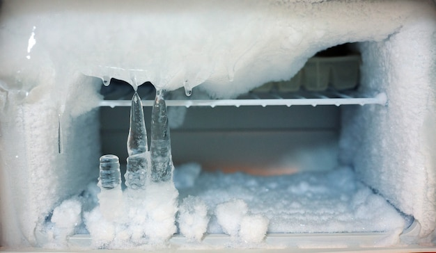Ice crystals icebox freezer in refrigerator Premium Photo