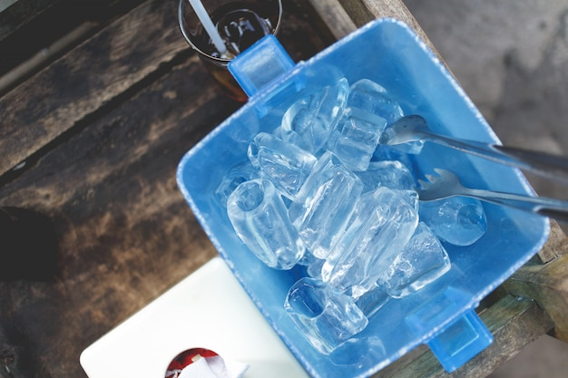 Ice cube in blue plastic basket. thai restaurant serving style.