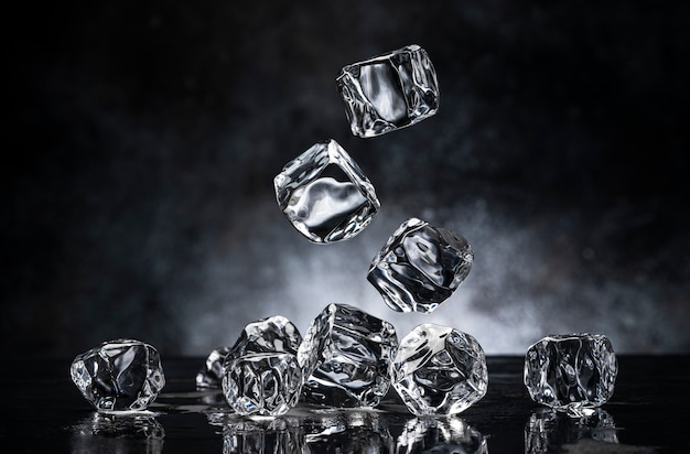 Ice cubes on black background with copy space