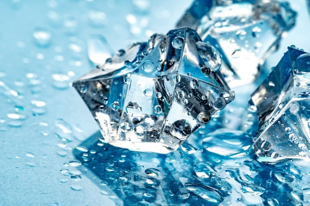 Ice cubes on blue
