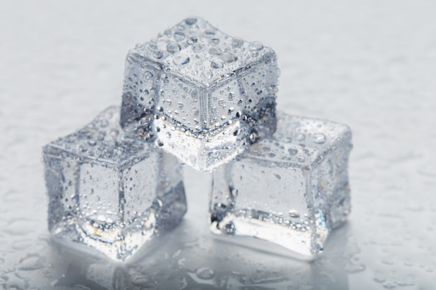 Ice cubes in the form of a pyramid with water drops close - up in macro