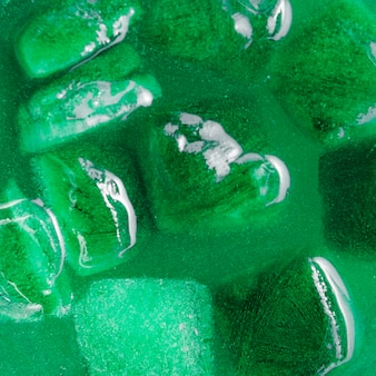 Ice cubes in green drink