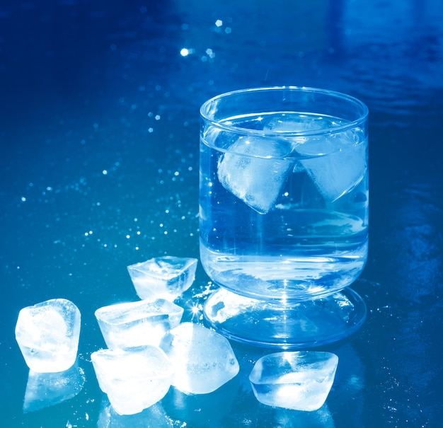 Ice cubes on an iced water surface